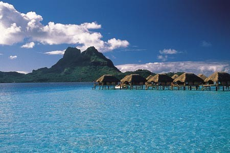 The South Pacific Lagoon and Bungalows at the Bora Bora Pearl Beach Resort